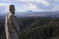 Temple statue and view of Montserrat - Barcelona, Spain
