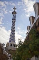Gaudí's four-armed cross over pavilion at Park Güell - Barcelona, Spain