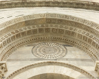 Detail of the reliefs on the archivolts of the Baptistery's south door - Pisa, Italy