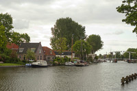 Vessels in the Vecht and houses of Weesp on the riverbank - Weesp, Netherlands
