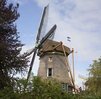 The Eendragt windmill waving the Weesp flag - Weesp, Netherlands