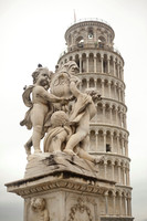 The Putti Fountain and the Tower of Pisa - Pisa, Italy