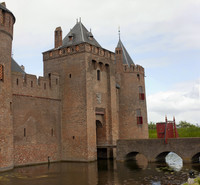 Façade of Muiden Castle entrance and the stone bridge and drawbridge - Muiden, Netherlands