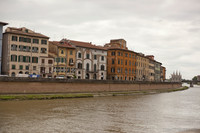 Buildings along the Arno in Pisa and the Gothic silhouette of Santa Maria della Spina - Pisa, Italy
