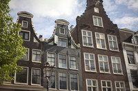Façades of houses along the canals of Amsterdam - Amsterdam, Netherlands