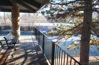 Riverwalk terrace next to a pine tree - Naperville, United States