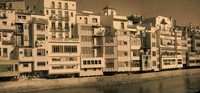 Façade of the buildings along the east shore of the Onyar - Girona, Spain