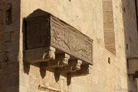 Sarcophagus on the façade of Sant Feliu basilica - Girona, Spain
