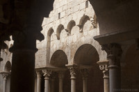 Arches on double columns in the monastery cloister - Girona, Spain