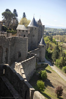 Walls along the street in front of the Aude Gate in the west side of the citadel - Carcassonne, France