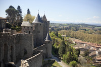 West part of the fortress of Carcassonne and the Pyrenees mountain range - Carcassonne, France