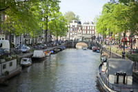 Bridge and boats in the Spiegelgracht canal of Amsterdam - Amsterdam, Netherlands