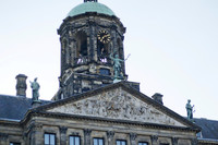 Detail of the tympanum and the tower of the Royal Palace Amsterdam - Amsterdam, Netherlands